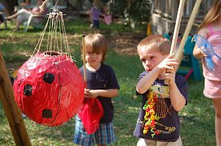 two boys hitting a pinata