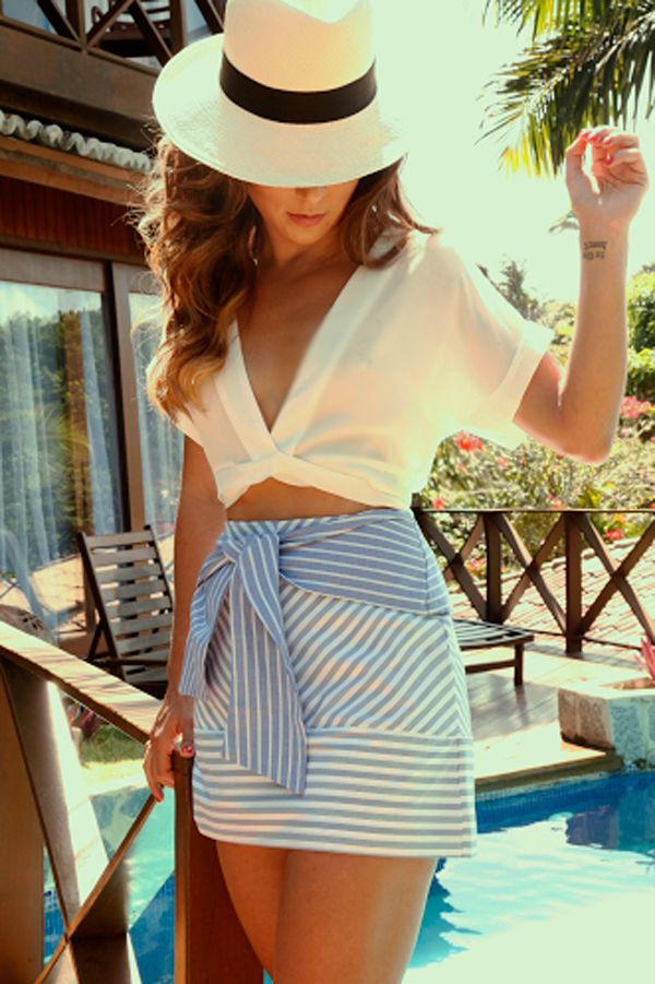 how to style a hat : white v-neck top and striped skirt