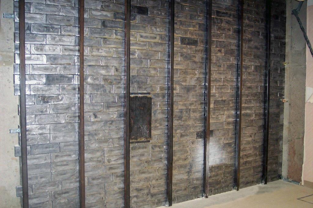 A Cracked Door Lead Brick Wall