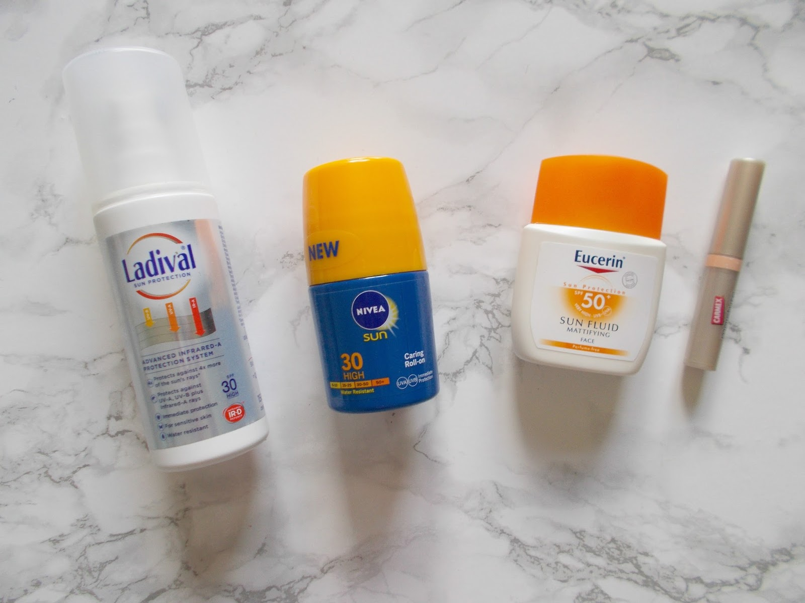 sunscreen ladival spf eucerin mattifying fluid nivea caring roll on carmex moisture plus lip balm
