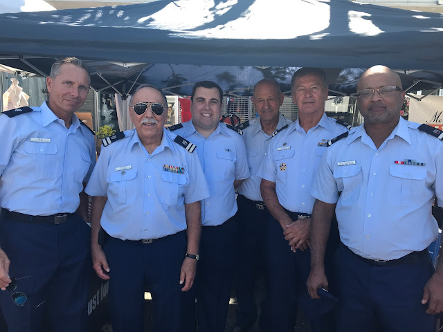 US Coast Guard Auxiliary Flotilla Manasquan Inlet members (left to right) Scott Okal, Bill Castagno, Christopher Orlando, Rocco Summa, Bill Iwanyk and David Witherspoon gathered in the boating safety booth at the 41st Annual Point Pleasant Beach Festival of the Sea.