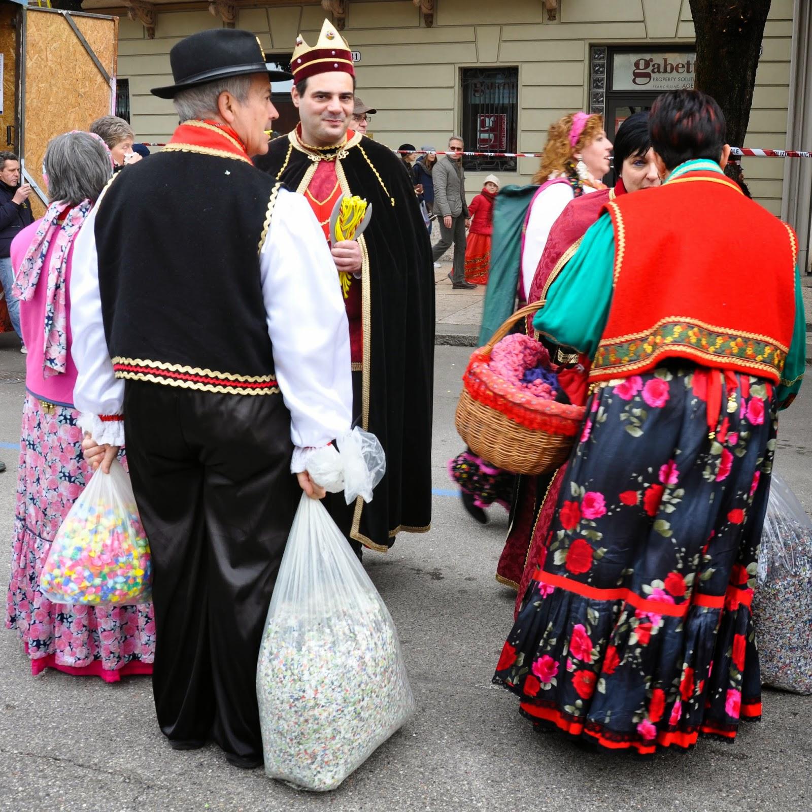 People in costume waiting for the parade in Verona on Venerdi Gnocolar to start