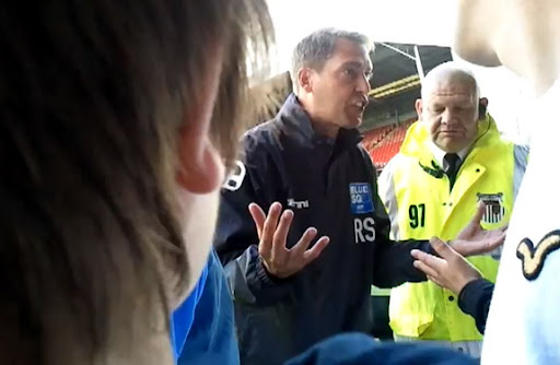 Grimsby manager Rob Scott confronts angry supporters after a league match against Darlington