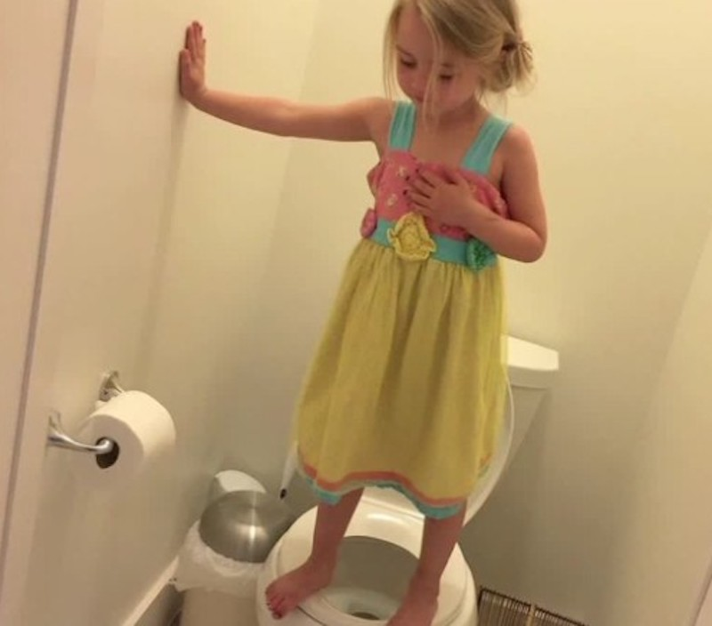 Three Year old stands on toilet practicing lockdown drill. A few Numbers