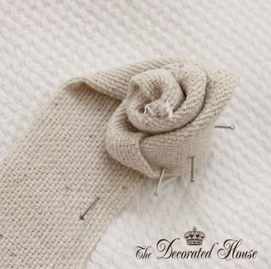 How To Make a Fabric Flower Rosette ~ The Decorated House. So easy, step by step instructions.