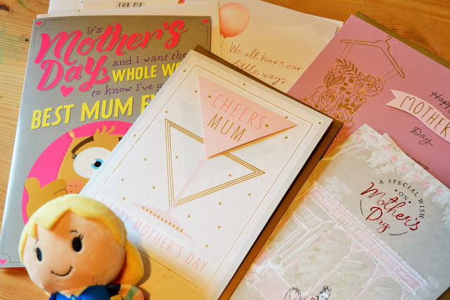 Mother's Day cards and a small soft toy Supergirl.