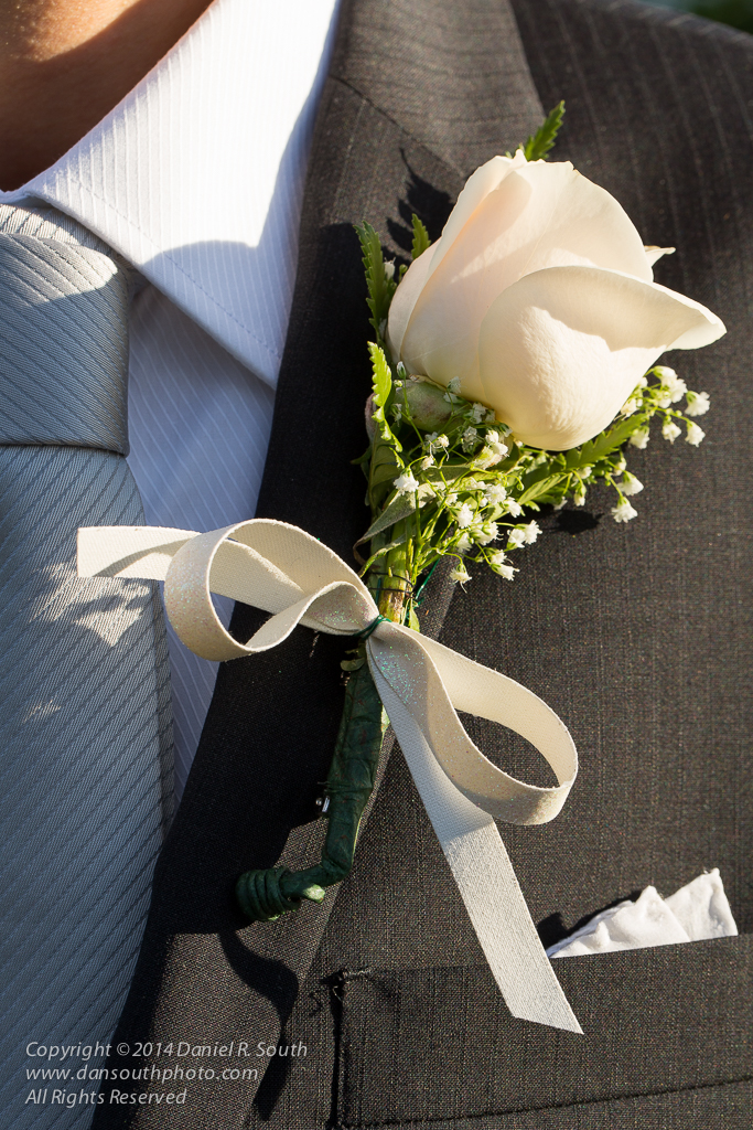 an abstract wedding photograph of the groom's corsage by daniel south