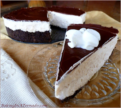 No Bake White Russian Cheesecake, flavors of a White Russian cocktail in a no bake cheesecake filling sandwiched between a chocolate cookie crust and a chocolate glaze | Recipe developed by www.BakingInATornado.com | #recipe #dessert