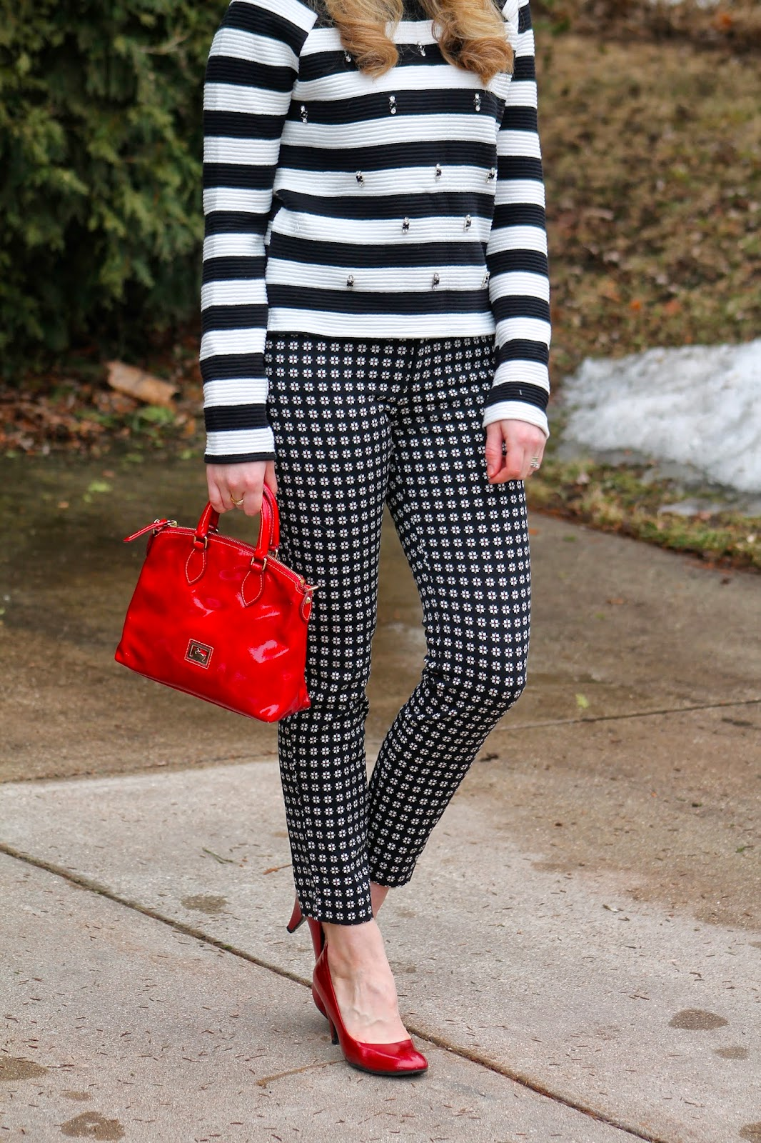 striped embellished top with patterned pixie pants red accessories
