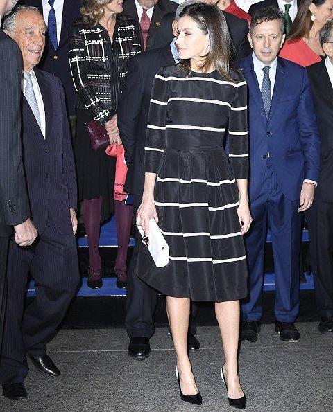Queen Letizia wore a new flare striped cocktail dress by Carolina Herrera