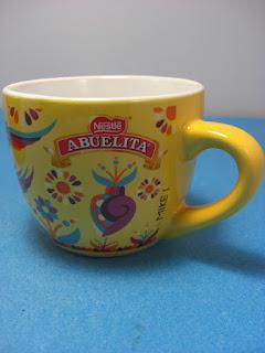 http://bargaincart.ecrater.com/p/23773731/chocolate-abuelita-corazones-mug