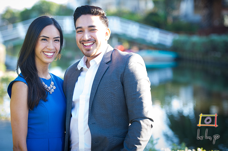 A gorgeous shallow depth of field shot of the engaged couple at the Venice Canals.