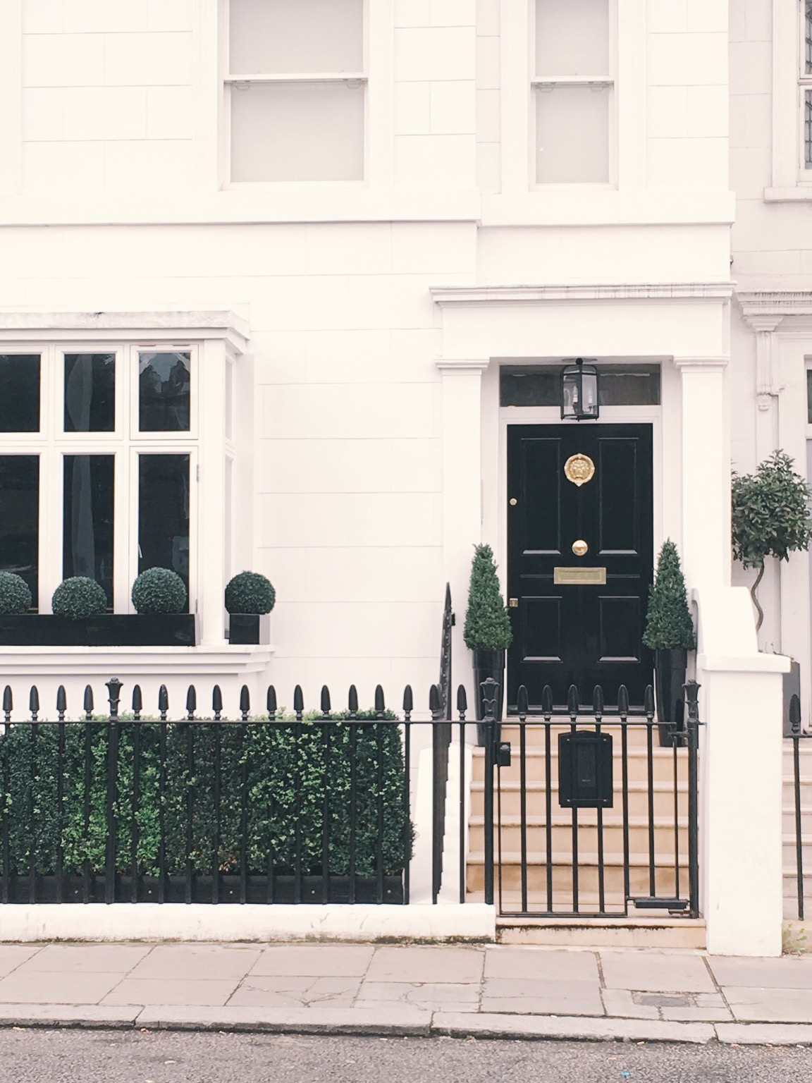 White exterior with black fence and door in London