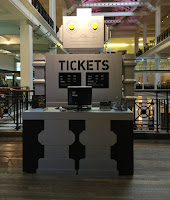 Pic of grey, robot-shaped ticket desk