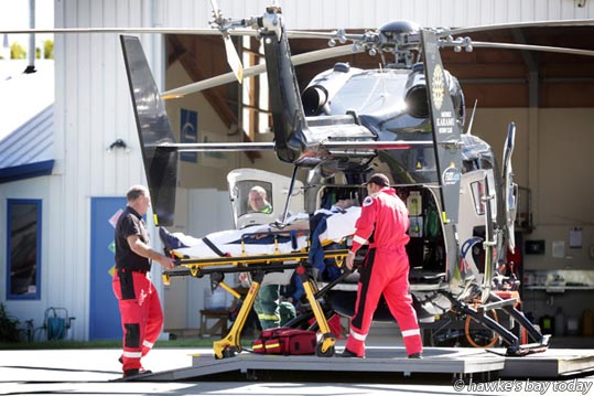 Staff of the Lowe Corporation Rescue Helicopter at the Hawke's Bay Hospital, Hastings unload an injured driver who crashed while competing in the Targa Rally on Crownthorpe Settlement Rd, near Sherenden. photograph