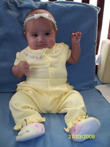 91913e897 above photo is our first born Jadyn at 2 months and 8 days…she wore a pair  of yellow pants and top