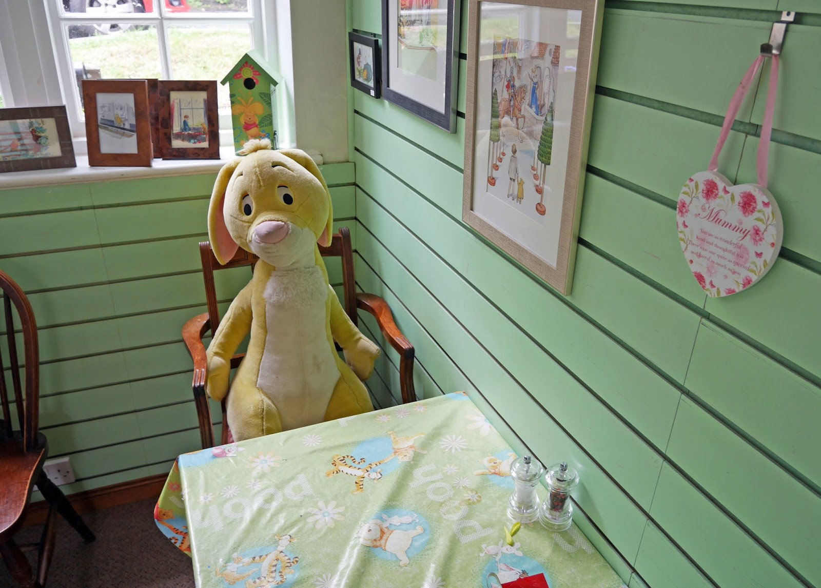 Rabbit sitting at a table at Pooh Corner, Ashdown Forest
