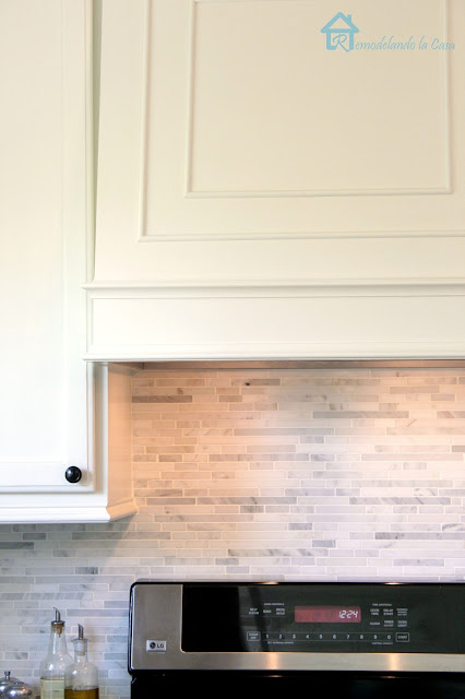 How to install a marble backsplash and molding to regular kitchen cabinets.