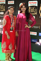 Monal Gajjar in Maroon Gown Stunning Cute Beauty at IIFA Utsavam Awards 2017 076.JPG