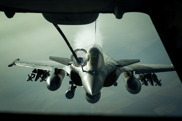 FILE PHOTO: A French Dassault Rafale jet receives fuel from a U.S. Air Force KC-10 tanker aircraft near Iraq October 26, 2016. U.S. Air Force/Senior Airman Tyler Woodward/Handout via REUTERS/File Photo