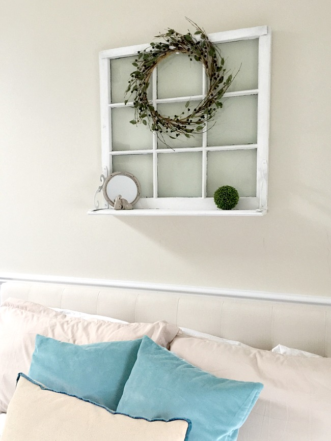 Beautiful window shelf using brackets, shelves, paint and old window.