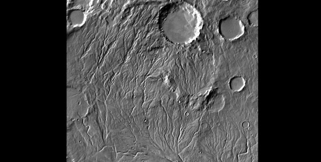 Extensive valley networks spidering through the southern highlands of Mars suggest that the planet was once warmer and wetter, but new research shows that water could still have flowed intermittently on a cold and icy early Mars. NASA/JPL-Caltech/Arizona State University