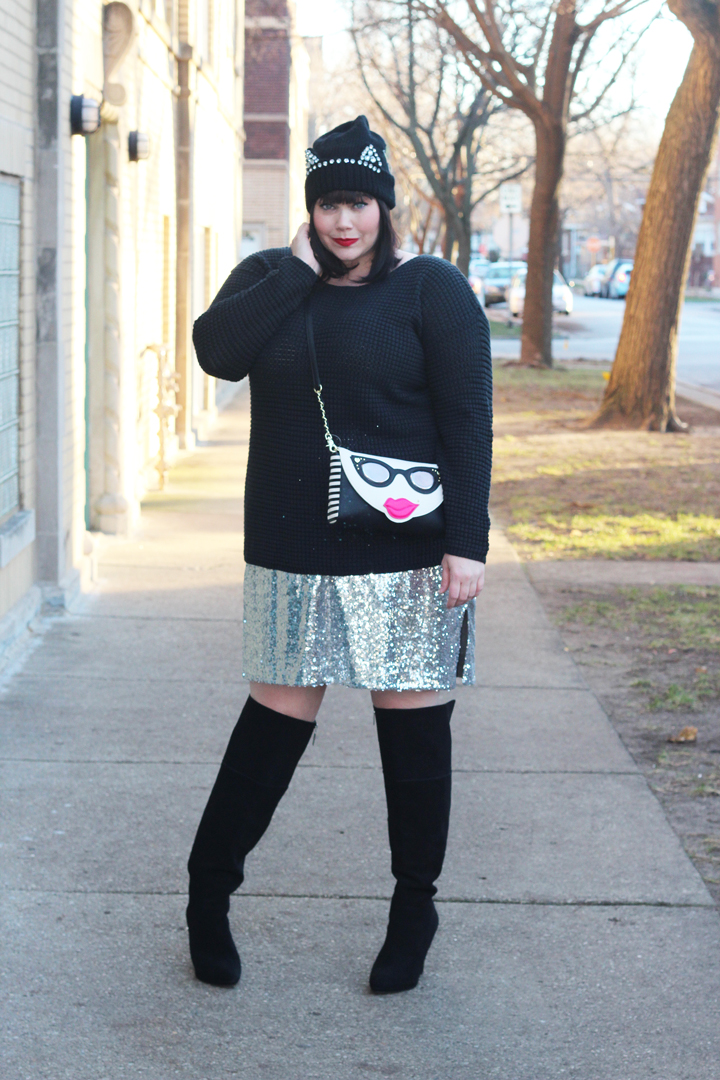 Plus Size Blogger Amber in plus size black sweater,sequin skirt, wide calf over the knee boots, cat hat and Betsey Johnson Bag