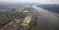 "This May 12, 2005, file photo, shows the port of Longview on the Columbia River at Longview, Wash. The Department of Ecology said Tuesday, Sept. 26, 2017, it rejected a water quality permit that Millennium Bulk Terminals wanted because the proposed facility near Longview in southwest Washington state would have caused ""significant and unavoidable harm"" to the environment. (Photo Credit: Elaine Thompson, AP) Click to Enlarge."