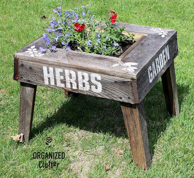 Garage Sale Weathered Wood Junk Garden Planter #oldsignstencils #gardenjunk #junkgarden #containergarden #nemesia #lobelia