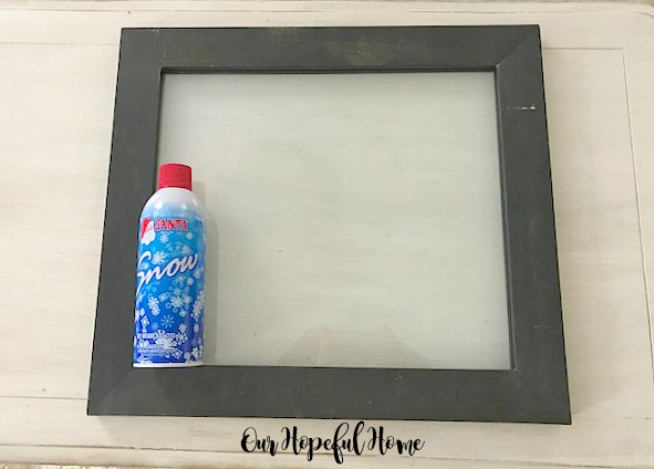 black double glass frame can of snow