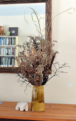 vase of dried weeds