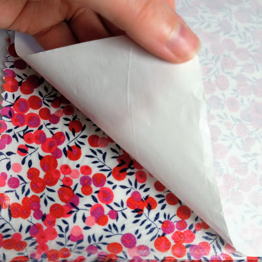 Silhouette Clean Cut Fusible Fabric Stabiliser.  Iron on wrong side of fabric and remove paper backing before cutting right side up.  Tutorial for No Sew Fabric Applique with HTV Edging from Silhouette UK Blog
