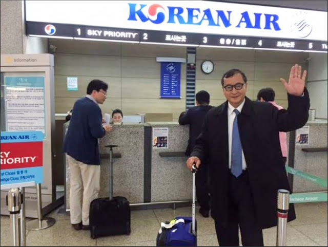 Sam Rainsy poses at a South Korean airport in November last year before announcing he would not return to Phnom Penh. Facebook