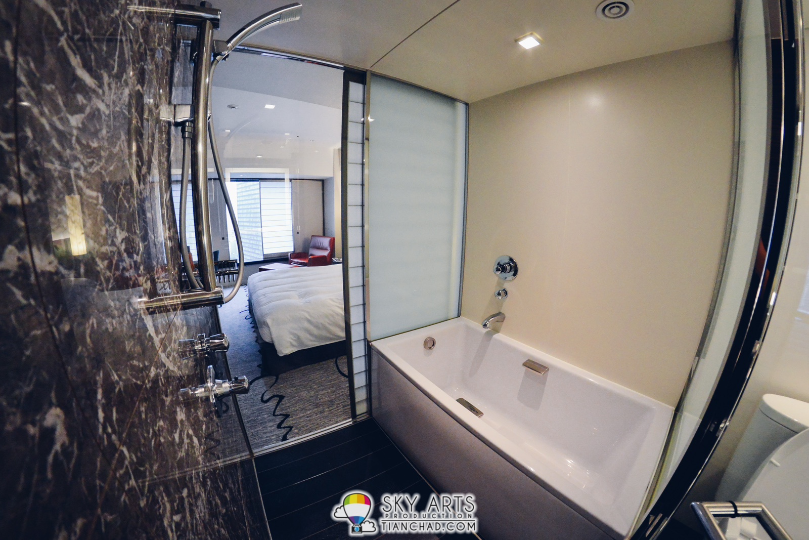 The Bath Room Has A Tub And Shower With Transparent Glass Link To