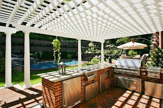 cool patio on backyard design with white wood pergola above bricks kitchen cabinets on tile floor face to awesome pool