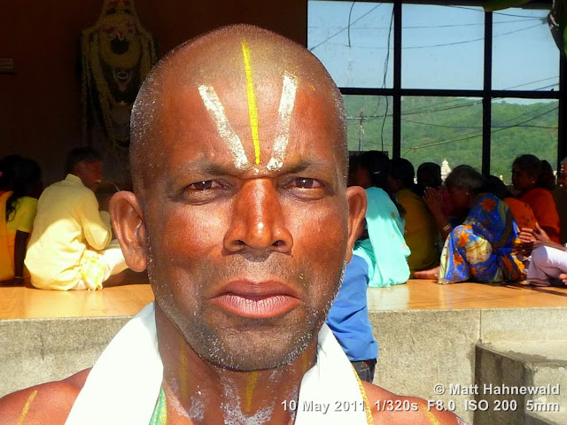 Facing the World, © Matt Hahnewald, street portrait, Dravidian people, South India, Tirupati, headshot, Hindu man, shorn, Vishnu sign on forehead