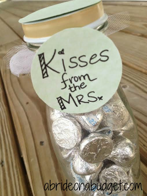 Give your bridesmaids a sweet treat with this Kisses From The Mrs. wedding craft from www.abrideonabudget.com.