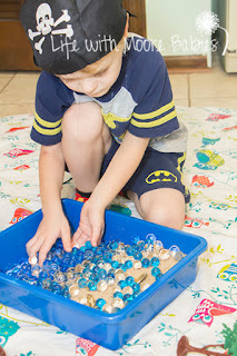 Water Beads and Sand make a fun sensory bin