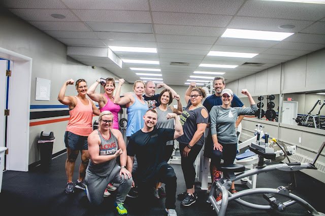 Improving Your Health: Photo of Gym Family