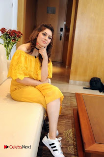 Actress Hansika Motwani Latest Stills in Yellow Dress  0005.jpg
