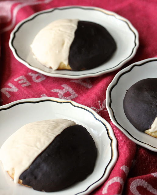 Black and White Cookies consist of a four inch diameter cake-like vanilla cookie thinly glazed with vanilla and chocolate icing.