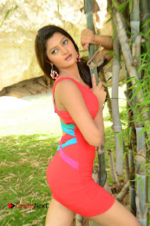 Actress Poojitha  Pictures in Red Short Dress at Bullet Movie Opening  0042