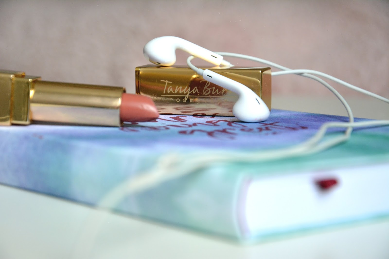 Apple EarPods; Maisons Du Monde Pineapple Trinket Dish, Hema Notebook; Tanya Burr Lipstick Pink Cocoa