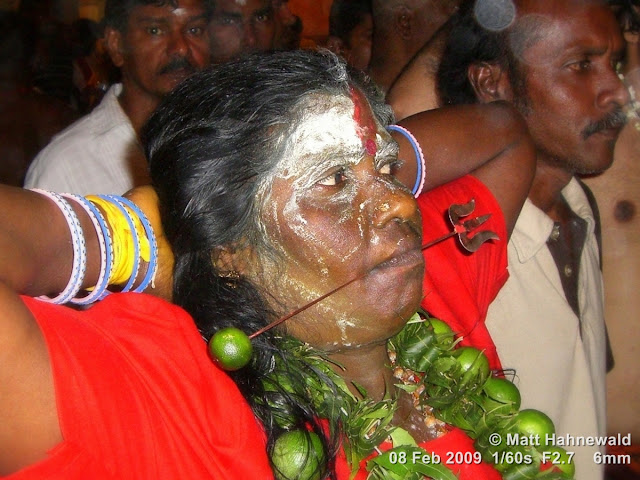 Thaipusam Festival, Malaysia, Kuala Lumpur, Batu Caves, kavadi attam, ceremonial sacrifice, ceremonial offering, Tamil woman, Hindu woman, Malaysian Indian woman, street portrait, ritualised piercing, ritualised mutilation, self-mutilation