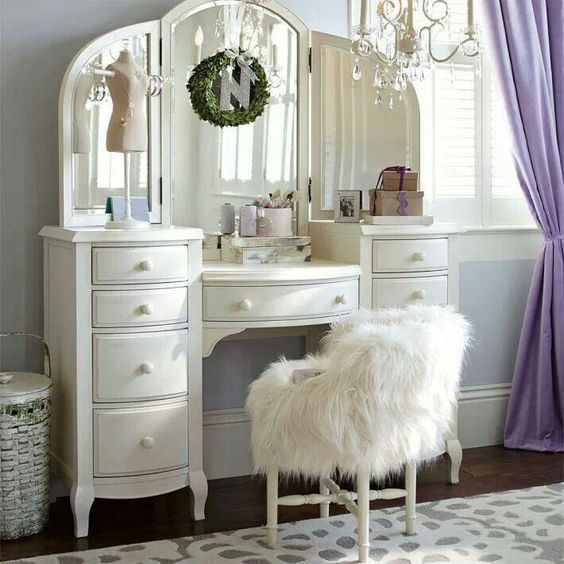 white makeup table with storage and chair