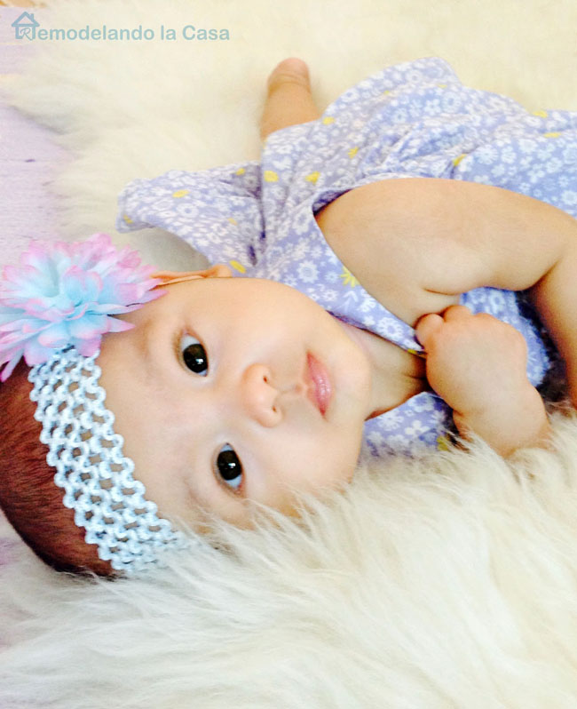 Baby girl Antonia on purple dress with beautiful head band with flower