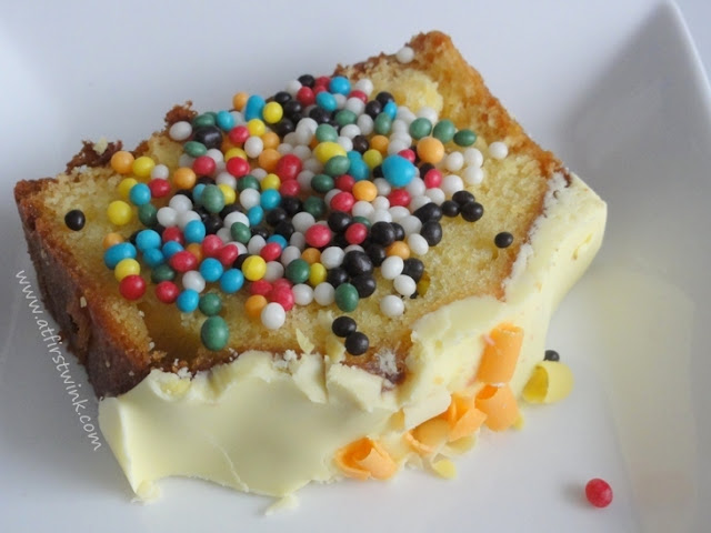 a slice of lemon fudge cake with colorful sprinkles on top