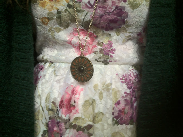 Floral dress with a pendant necklace