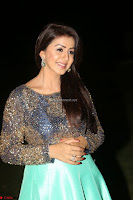 Nikki Galrani in Green Skirt  Top at Marakathamani music launch ~  Exclusive (128).JPG