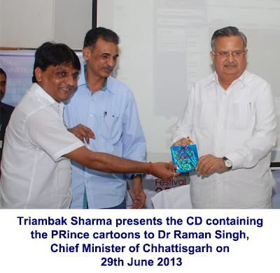 Dr Raman Singh, Chief Minister of Chhattisgarh receiving the CD containing PRince cartoons from Triambak Sharma
